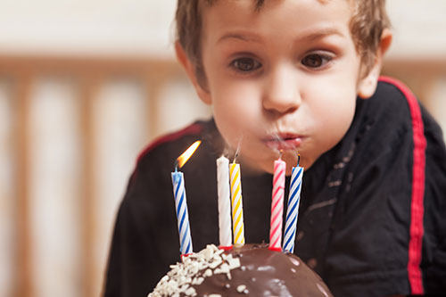 boy-blowing-candles